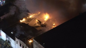 A large fire burned at a single-story commercial building in South Los Angeles on Dec. 11, 2015. (Credit: KTLA)