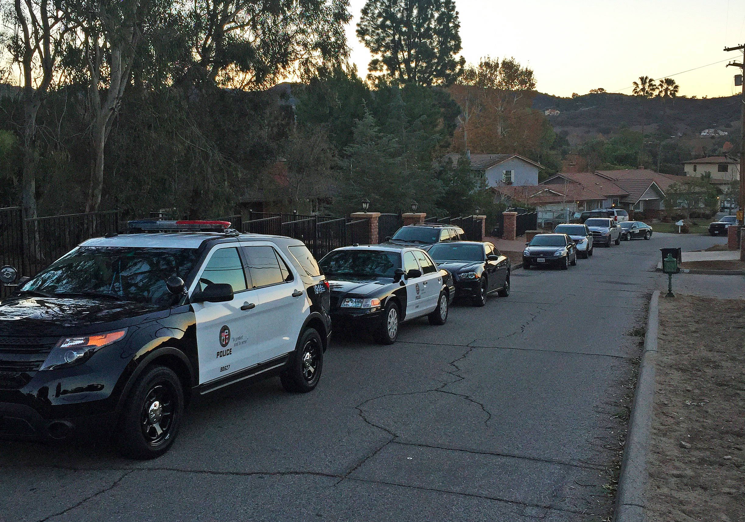 Patrol vehicles are seen during an LAPD Internet Crimes Against Children task force search of a home in Sunland on Dec. 29, 2015, in a photo provided to KTLA by a neighbor.