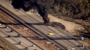 A tanker truck burned on the 15 Freeway near Lake Elsinore on Dec. 1, 2015. (Credit: KTLA)