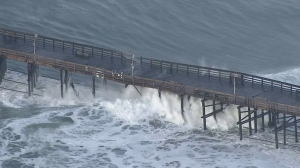 Powerful waves hit the Ventura Pier, causing damage and forcing officials to close it on Dec. 11, 2015. (Credit: KTLA)