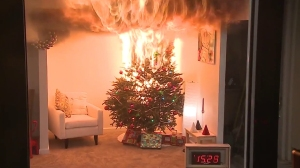A Christmas tree engulfed in flames is seen in a U.S. Consumer Product Safety Commission video posted on YouTube on Dec. 8, 2015.
