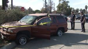 Police chased a suspect who carjacked this Dodge Durango on Jan. 1, 2016. It crashed in Long Beach on Wardlow Road near Maine Avenue. (Credit: Jack Leonard/Los Angeles Times)