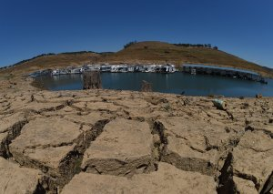Dried mud and the remnants of a marina are shown at the New Melones Lake reservoir, on May 25, 2015, when it was at less than 20 percent capacity. (Credit: MARK RALSTON/AFP/Getty Images)