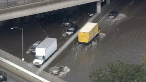 Flooding on the 5 Freeway in Sun Valley made the roadway look like a lake on Jan. 6, 2016.