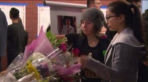 Students, parents and teachers left flowers and gifts at the vigil for the slain teenagers on Jan. 25, 2016. (Credit: KTLA)