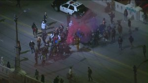 Police were called in when hundreds of people and cars began to gather on the iconic Sixth Street Bridge on Jan, 26, 2016. (Credit: KTLA)