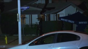 Downey police investigate a fatal home invasion robbery on Sunday, Jan. 18, 2016. (Credit: KTLA)