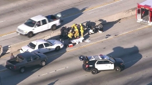 A CHP motorcycle officer was involved in a crash on the 170 Freeway in Burbank on Jan. 25, 2016. (Credit: KTLA)