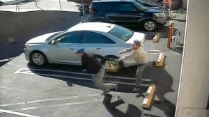LAPD provided video of a robbery in the parking lot of the Church of Assumption in Boyle Heights on Jan. 12, 2016.