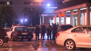 Police investigate the fatal shooting of a 17-year-old woman in Del Rey on Jan. 6, 2016. (Credit: KTLA)