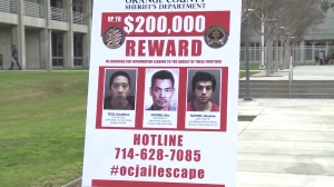 Photos of the Santa Ana jail escapees were shown at a Jan. 28, 2016, news conference. (Credit: KTLA)