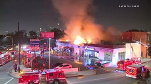 A fire tore through a strip mall in Boyle Heights Friday morning. (Credit: Loudlabs)