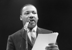 The US clergyman and civil rights leader Martin Luther King addresses, 29 March 1966 in Paris' Sport Palace the militants of the 'Movement for the Peace'. (Credit: /AFP/Getty Images)