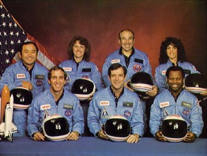 Space Shuttle Challenger crew members gather for an official portrait November 11, 1985 in an unspecified location. (Back, L-R) Mission Specialist Ellison S. Onizuka, Teacher-in-Space participant Sharon Christa McAuliffe, Payload Specialist Greg Jarvis and mission specialist Judy Resnick. (Front, L-R) Pilot Mike Smith, commander Dick Scobee and mission specialist Ron McNair. (Photo by NASA/Getty Images)