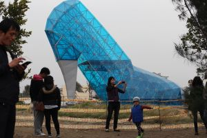 Tourists take pictures in front of a shoe-shaped church in southern Chiayi on Jan. 11, 2016. The church, which measures 55 feet tall and 36 feet wide, took two months to build. (Credit: STR/AFP/Getty Images)