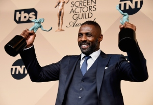 Actor Idris Elba, winner of Outstanding Performance by a Male Actor in a Supporting Role for 'Beasts of No Nation,' and Outstanding Performance by a Male Actor in a Television Movie or Miniseries for 'Luther,' poses in the press room during the 22nd Annual Screen Actors Guild Awards at the Shrine Auditorium on Jan. 30, 2016, in Los Angeles. (Credit: Frazer Harrison/Getty Images)