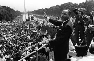 """The civil rights leader Martin Luther KIng (C) waves to supporters in August 1963 on the Mall in Washington DC during the """"March on Washington."""" King said the march was """"the greatest demonstration of freedom in the history of the United States."""" (Credit: -/AFP/Getty Images)"""