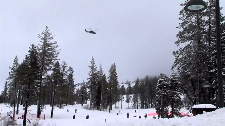 A helicopter searches for Carson May at Sugar Bowl Resort on Jan. 18, 2016. (Credit: KTXL)
