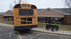 A woman died and two children were injured Tuesday after being struck by a school bus in Lawrence, Indiana. (Credit: Indianapolis Fire Department)