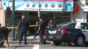 LAPD investigators were on scene at a jewelry store in Chinatown on Jan. 7, 2016. (Credit: KTLA)