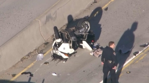 The crash left the officer's motorcycle upside down near the center divider of the 170 Freeway. (Credit: KTLA)