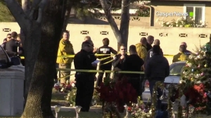 Police and firefighters are seen at a cemetery in Ontario after a shooting on Jan. 2, 2016. (Credit: Casper News)