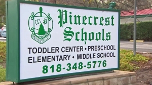 A sign in front of the Pinecrest school in Woodland Hills is seen on Jan 19, 2016. (Credit: KTLA)
