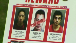 A poster displayed at a Jan. 29, 2016, news conference reflected the search for 2 missing inmates. (Credit: KTLA)