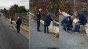 Photos provided by the Riverside Fire Department show a fire captain giving a pair of shoes to a homeless man on Jan. 11, 2016.