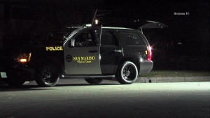 A woman was punched and forced to open a safe during a home invasion robbery in San Marino on Jan. 26, 2016. (Credit: OnScene.TV)