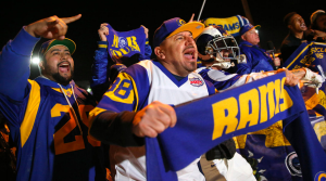 Alfredo Prieto, center, joins dozens of other Rams fans at Hollywood Park on Jan. 12, 2016, to celebrate the team's homecoming. (Credit: Robert Gauthier / Los Angeles Times)