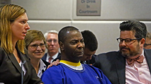 Kash Register begins to cry after realizing he is a free man. He spent 34 years in prison after being wrongfully convicted of killing a man in West Los Angeles. (Credit: Anne Cusack / Los Angeles Times)