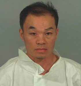 The Garden Grove Police Department released this photo of Thang Van Nguyen on Jan. 19, 2016, after he was accused of attempting to kill his wife using a meat cleaver.