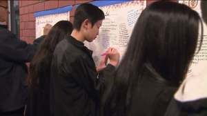 Friends and classmates left messages for the two slain teenagers and their families on Jan. 25, 2016. (Credit: KTLA)