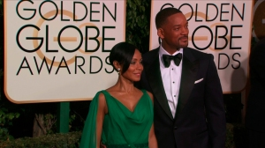 Will Smith and Jada Pinkett Smith on the red carpet before the 73rd Golden Globe awards in Los Angeles, January 10, 2016. (Credit: Pool)