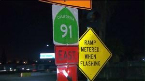 A 91 Freeway sign is seen in Corona. (Credit: KTLA)