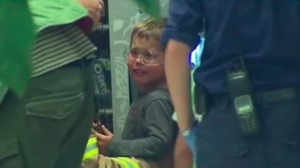 A 4-year-old boy got his arm stuck in a vending machine in Melbourne, Australia. (Credit: Seven Network via CNN)