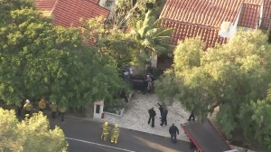 A second vehicle was damage near where a car landed on a garage roof in Palos Verdes Estates on Feb. 3, 2016. (Credit: KTLA)