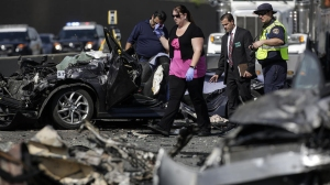CHP investigators and coroner's officials gather evidence from Saturday's fatal crash on the 5 Freeway in Commerce. (Credit:(Credit: Irfan Khan / Los Angeles Times)
