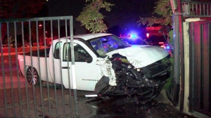 A truck came to a stop after crashing into an apartment complex gate in Garden Grove on Feb. 21, 2106. (Credit: OnScene.TV)