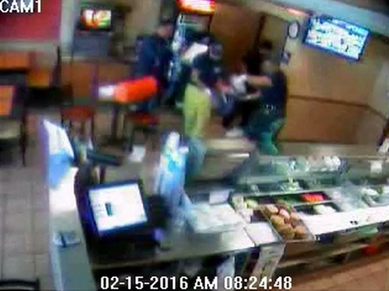 Surveillance video released by West Covina police showed firefighters taking a newborn out of Subway restroom on Feb. 15, 2016.