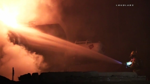 Firefighters battled 30 foot flames after a tar-filled tanker caught fire in Ontario on Feb. 23, 2016. (Credit: Loudlabs)