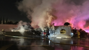 A fiery crash involving an overturned big rig in the Commerce area shut down both sides of the 5 Freeway on Feb. 27, 2016. (Credit: John A. Moreno/KTLA)