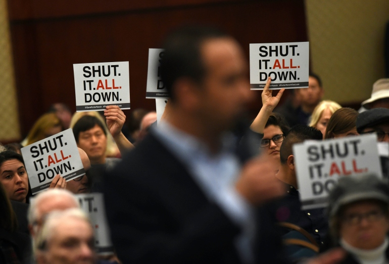 A Porter Ranch resident addresses an AQMD board over the continuing gas leak on Jan. 23, 2016. (Credit: MARK RALSTON/AFP/Getty Images)
