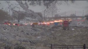 Drivers moved along a snowy 5 Freeway in the Grapevine area on Jan. 31, 2016. (Credit: KTLA)