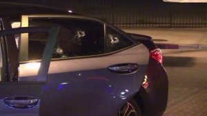 Bullet holes are seen in a car after a fatal shooting in Lincoln Heights on Feb. 9, 2016. (Credit: Loudlabs)