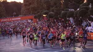 Elite runners take off at the start of the 30th L.A. Marathon at Dodger Stadium on Mar. 15, 2015. (Credit: Marcus Yam / Los Angeles Times)