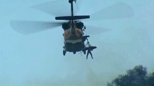 An inmate firefighter was airlifted after being injured in Malibu on Feb. 25, 2016. (Credit: KTLA)