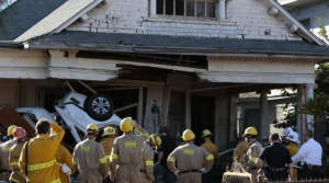 Two people died and one was injured after a vehicle crashed into a Boyle Heights home on Feb. 7, 2016. (Credit: Robert Gauthier/Los Angeles Times)