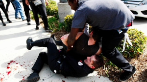 "Protesters scuffle with a Ku Klux Klansman after members of the KKK tried to start a ""White Lives Matter"" rally at Pearson Park in Anaheim. The event quickly escalated into violence. (Credit: Luis Sinco / Los Angeles Times)"